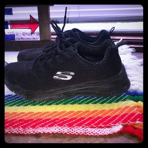 Skechers black on black sneakers.